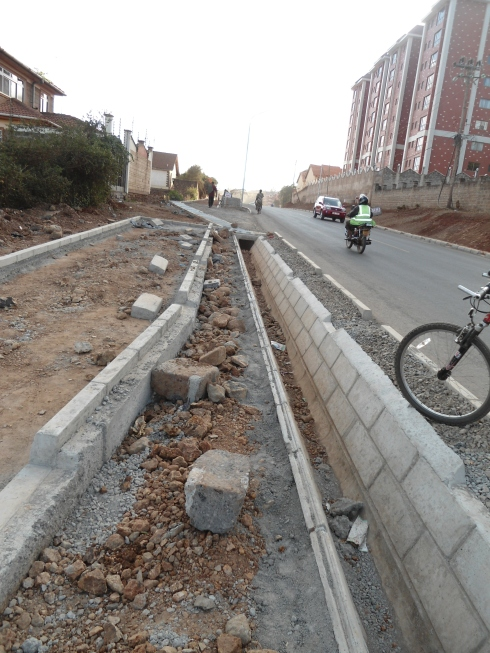 "The cycle lane narrows out as it gets ""chocked"" by the pedestrian foot path and road on Kileleshwa Ring Road"
