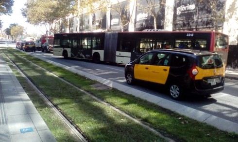 A complete street in Barcelona - note the tram tracks in the foreground , alongside a car - bus lane. Photo Credit - Ann Keih